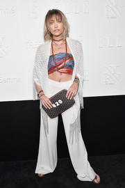 Paris Jackson rounded out her boho ensemble with a fringed white shawl by Missoni.