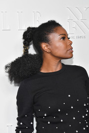 Gabrielle Union attended the NYFW kickoff party sporting a funky ponytail.