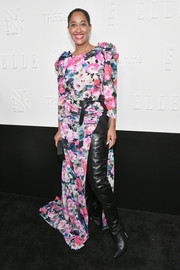 Tracee Ellis Ross contrasted her feminine gown with ultra-edgy leather legging boots for the NYFW kickoff party.