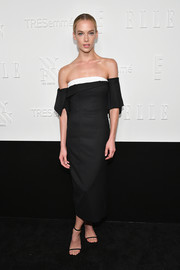 Hannah Ferguson was modern-chic in a structured off-the-shoulder dress by Monse at the NYFW kickoff party.