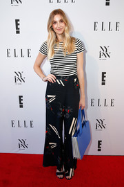 Whitney Port looked laid-back in a black-and-white striped tee at the E! + Elle + IMG party.