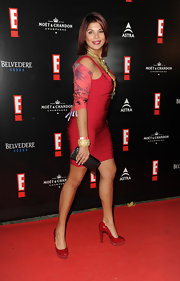 Indira Weis was red hot on the red carpet at the E! bash in Germany in red patent leather platform pumps.