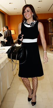 Cristina Parodi attended the E' Giornalismo Awards in a mod-inspired black and white dress with a rosette collar.