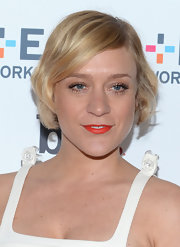 Chloe Sevigny strayed from the typical red lip when she opted for this tangerine shade.