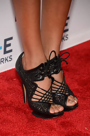 Dania rocked a pair of lace cutout ankle booties on the red carpet.