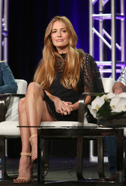 Cat Deeley teamed nude ankle-strap heels with a little black lace dress for the 2018 Winter TCA Press Tour.