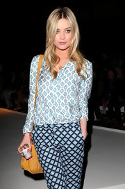 Laura Whitmore took a fashion risk with this mixed-print blouse and pants combo at the E. Tautz fashion show.