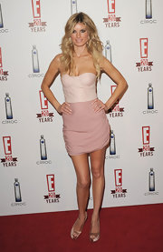 Marisa Miller paired her strapless dress with Christian Louboutin peep toe pumps.