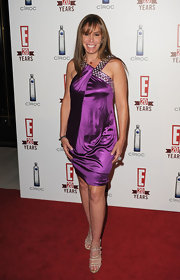 Melissa attended E! Television's 20th Birthday Celebration in this sassy silk purple draped dress.