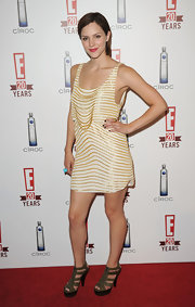 Katherine went semi-casual in a gold-embellished mini dress with leather, zip-front, platform sandals.