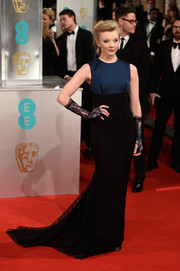 Natalie Dormer oozed sophistication in a two-tone Sophia Kah gown, punctuated with fingerless lace gloves, at the EE British Academy Film Awards.