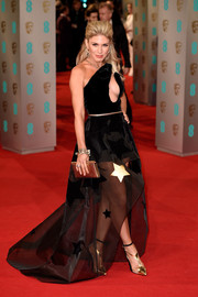 Hofit Golan brought a fun and sexy look to the 2015 British Academy Film Awards in a cutout gown with a sheer skirt by Stephane Rolland.