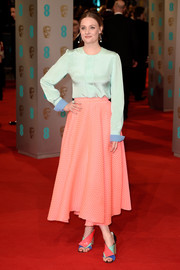 Romola Garai chose a pastel color-block look for the 2015 British Academy Film Awards in a gorgeous mint green blouse with contrast cuffs.