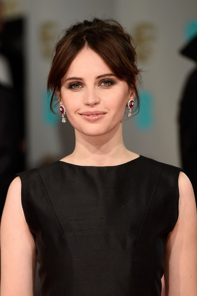 Felicity Jones injected an edgy vibe into her BAFTAs look with this messy center-parted updo.