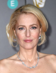 Gillian Anderson looked glam wearing this loose updo at the 2020 EE British Academy Film Awards.