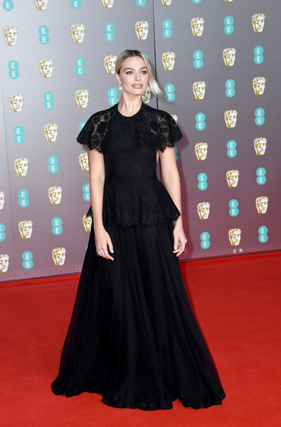 Margot Robbie looked downright elegant in a black Chanel Couture gown with a lace yoke and peplum at the 2020 EE British Academy Film Awards.