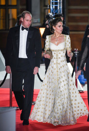 Kate Middleton looked divine in a white Alexander McQueen gown with gold embroidery at the 2020 EE British Academy Film Awards.