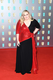 Rebel Wilson chose a red and black wrap gown by Prabal Gurung for the 2020 EE British Academy Film Awards.
