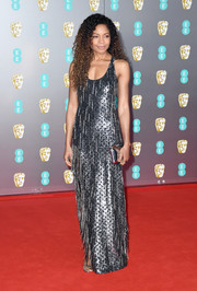 Naomie Harris went for high shine in a silver sequined column dress by Michael Kors at the 2020 EE British Academy Film Awards.