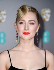 Saoirse Ronan went vintage-glam with this twisted updo at the 2020 EE British Academy Film Awards.