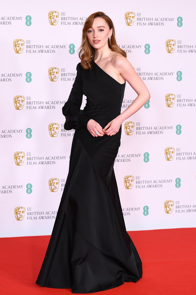 Phoebe Dynevor went for minimalist elegance in a black one-shoulder gown by Louis Vuitton at the 2021 BAFTAs.