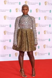 Cynthia Erivo looked opulent in a heavily embellished silver and gold cocktail dress by Louis Vuitton at the 2021 BAFTAs.