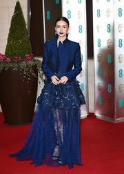 Lily Collins added a menswear-chic touch with a royal-blue cropped jacket.
