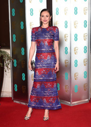 Olga Kurylenko kept it sleek and elegant in a sequined print dress by Armani Prive at the EE British Academy Film Awards.