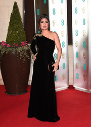Salma Hayek looked quite the diva in a black velvet one-shoulder gown by Gucci at the EE British Academy Film Awards.