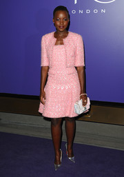 Lupita Nyong'o went for classic styling with this pink tweed skirt suit by Chanel Couture during the BAFTA nominees party.
