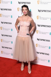 Anya Taylor-Joy complemented her frock with strappy beige pumps by Malone Souliers.