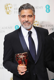 George Clooney's navy tie matched the navy trim in his two-toned suit at the BAFTA's.