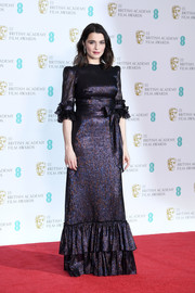 Rachel Weisz looked very girly in a ruffled purple lamé gown by The Vampire's Wife at the EE British Academy Film Awards.