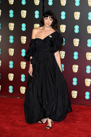 Caitriona Balfe was all about boho glamour in this black off-the-shoulder gown by The Row at the EE British Academy Film Awards.