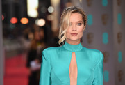 Laura Whitmore styled her hair into a boho-glam braided updo for the BAFTAs.
