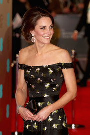 Kate Middleton accessorized with a black satin clutch by Alexander McQueen at the 2017 BAFTAs.