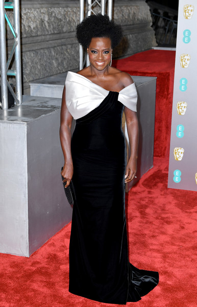 Viola Davis looked ultra glam in a black Armani Prive velvet gown with a contrast neckline at the EE British Academy Film Awards.