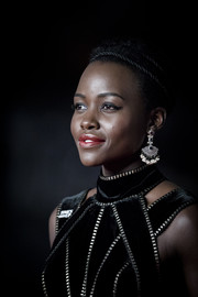 Lupita Nyong'o attended the EE British Academy Film Awards wearing a pair of Sanjay Kasliwal fan earrings.