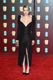 Emma Roberts looked fierce and fab in a Schiaparelli Couture LBD with a deep-V neckline, bold shoulders, and a high front slit at the EE British Academy Film Awards.