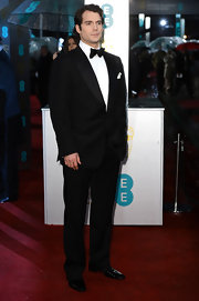 Henry Cavill looked suave and sophisticated in this classic tuxedo at the EE British Academy Film Awards.
