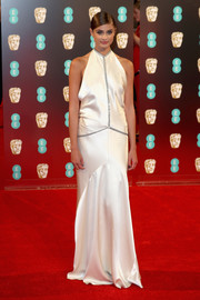 Taylor Hill chose an ivory halter gown with silver trim for her 2017 BAFTAs look.