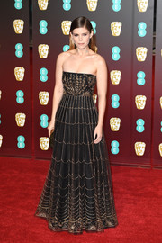Kate Mara looked enchanting in a strapless black Dior Couture gown with gold embroidery at the EE British Academy Film Awards.