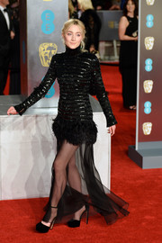 Saoirse Ronan paired black Jimmy Choo platform pumps with a Chanel gown for the EE British Academy Film Awards.