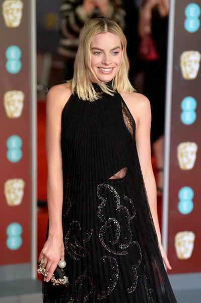 Margot Robbie attended the EE British Academy Film Awards carrying a bedazzled black satin clutch by Roger Vivier.