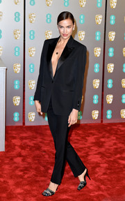 Irina Shayk went the masculine-chic route in a black tuxedo by Burberry at the EE British Academy Film Awards.