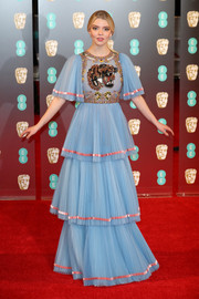 Anya Taylor-Joy donned a tiered blue Gucci gown with a tiger-beaded bodice and pink trim for the 2017 BAFTAs.