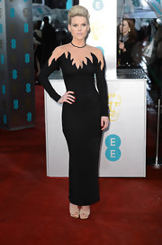 Alice Eve looked mind-blowingly '80s in this black gown with a decolletage of flames and nude mesh. That height-reaching 'do only added to the rock star effect.