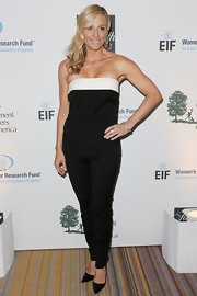 Jamie Tisch chose a black strapless jumpsuit with a white stripe across the bust for her cool and contemporary evening look.