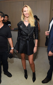 Candice Swanepoel rocked leather on leather with this biker jacket and mini dress combo during Rihanna's party.