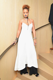 Rihanna looked vampy in a white velvet slip dress by Ellery during her party.